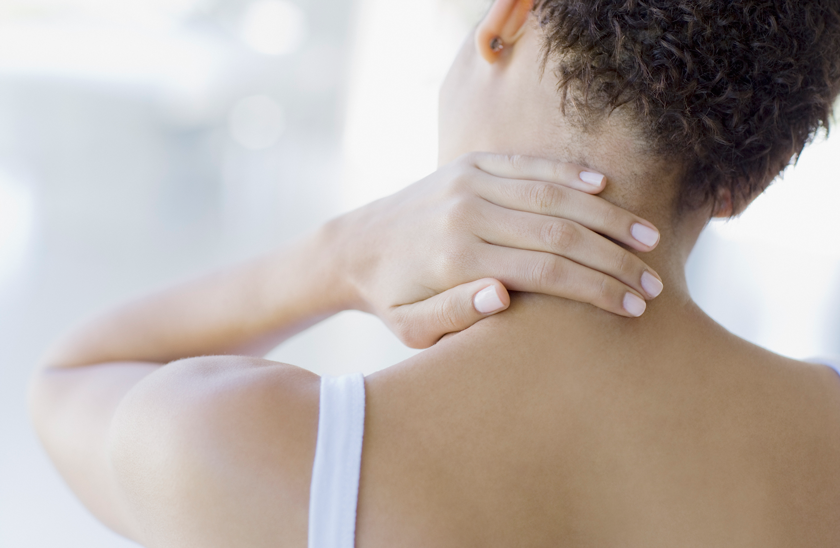 woman relieving neck pain
