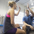 young man and woman high five after their workout