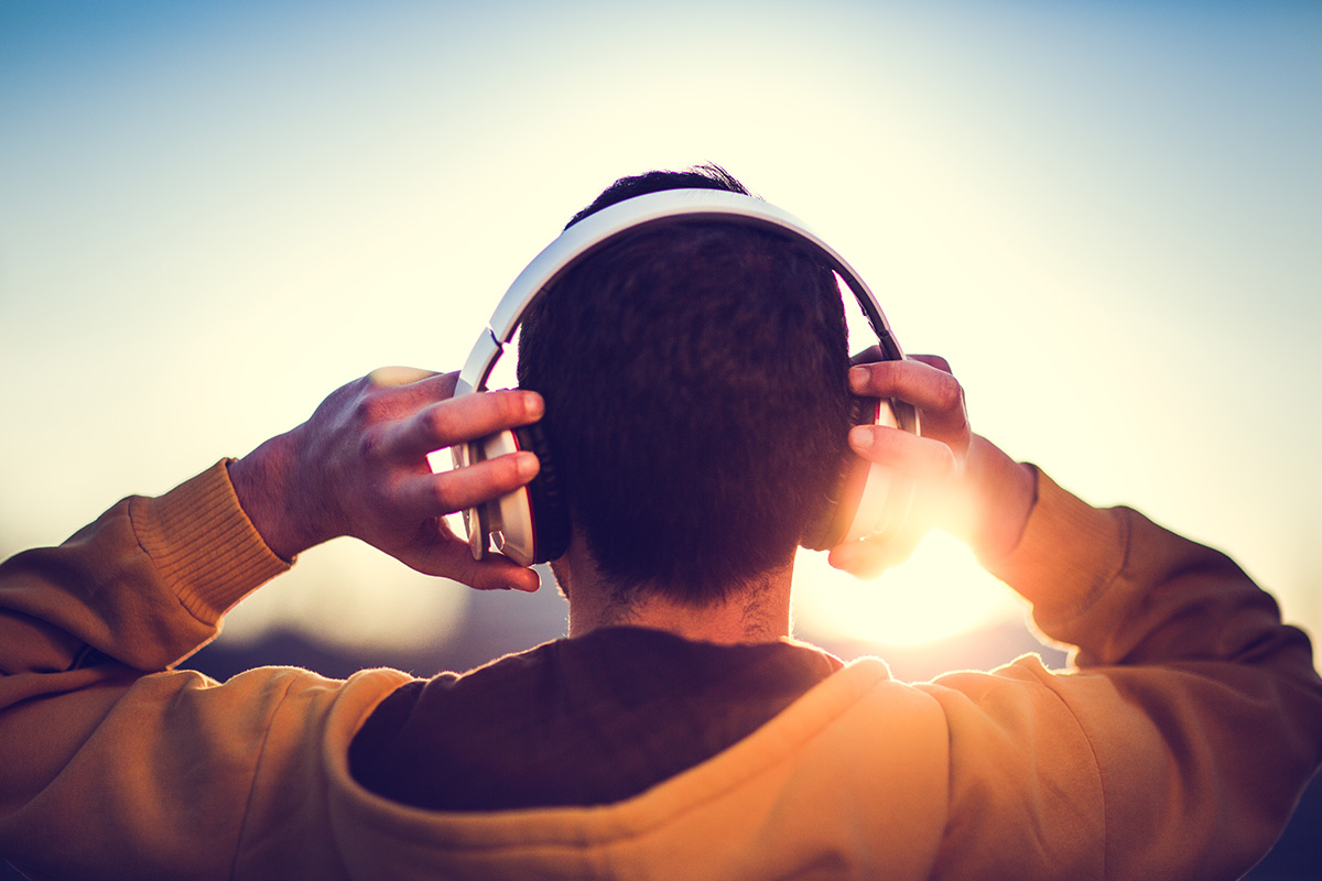 man listening to music outside
