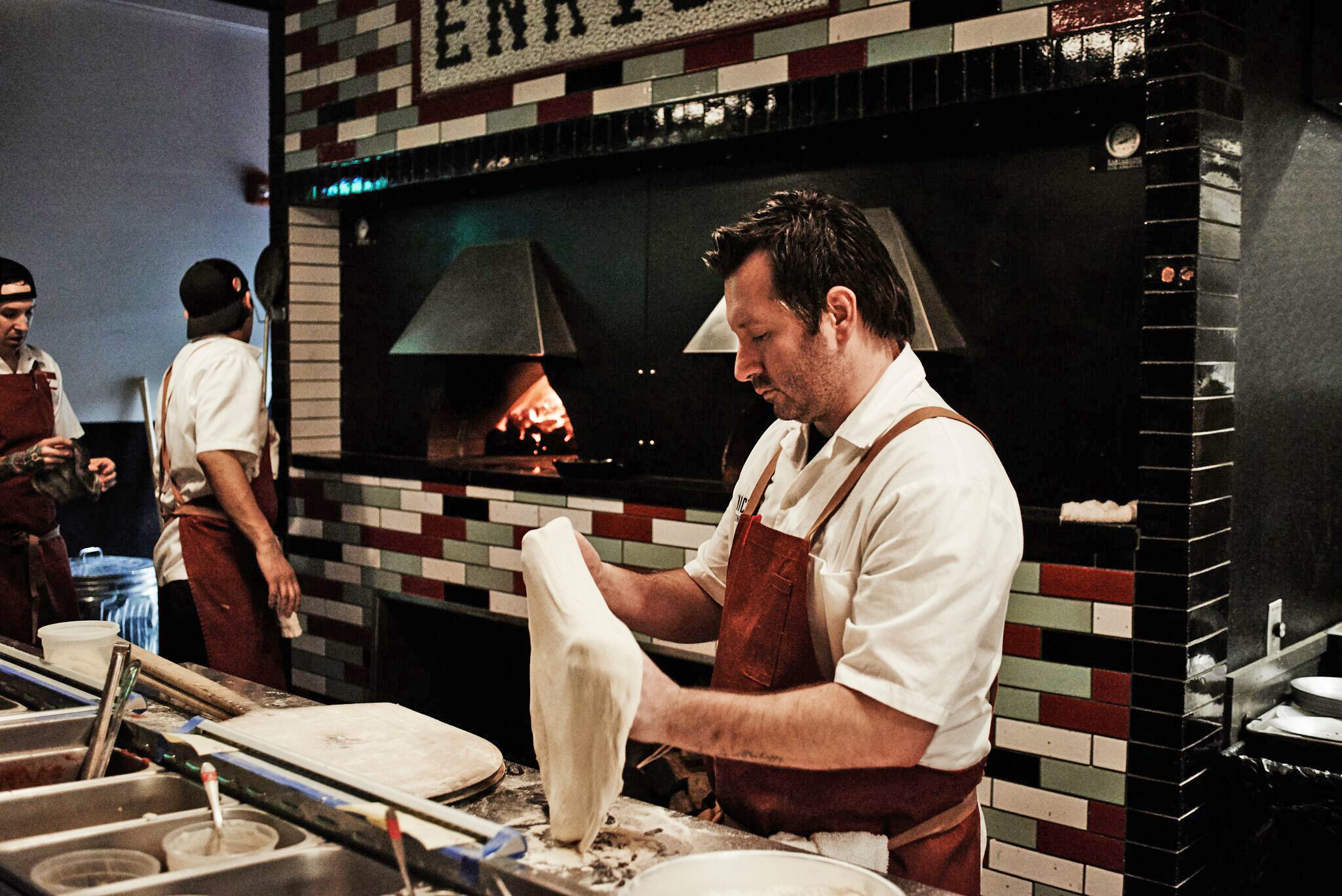 tony galzin from nicky's coal fired in nashville working pizza dough