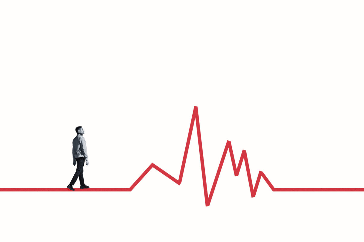 Full length side view of young man walking on red line graph against white background