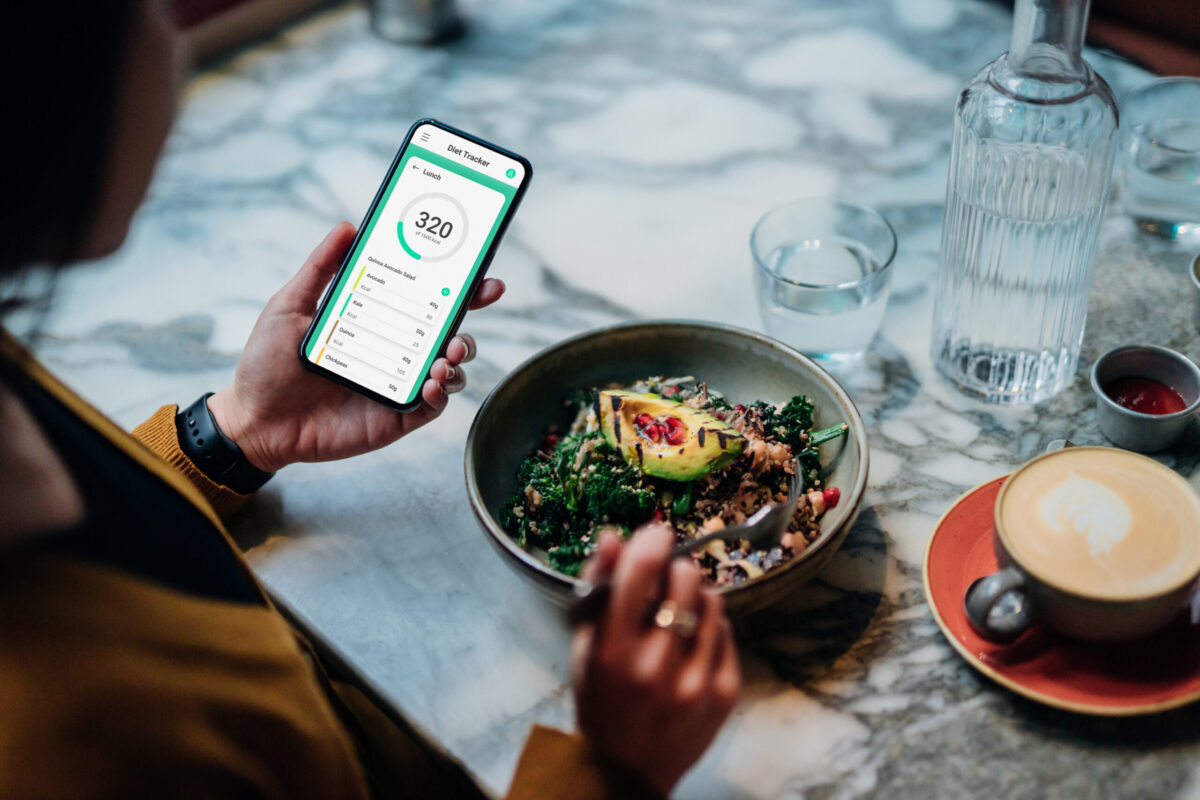Young Woman Using Meal Planning Mobile App for a Healthy Diet